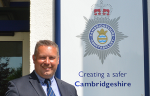 Commissioner in front of Cambridgeshire Constabulary building